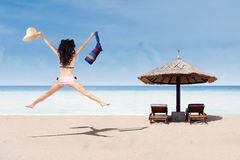 Happy woman in bikini jumping at beach Royalty Free Stock Images