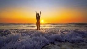 Happy Woman in Bikini Jumping in Sea Sunset royalty free stock photos