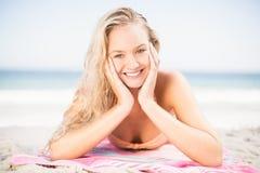 Happy woman in bikini lying on the beach Stock Photos