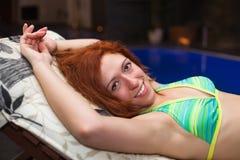 Happy woman in bikini relaxing Stock Image