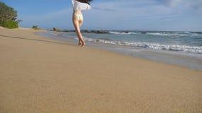 Happy woman in bikini and shirt running at the ocean beach. Young beautiful girl enjoying life and having fun at sea. Shore. Summer vacation or holiday stock video