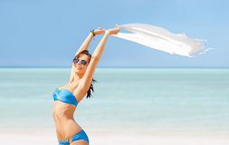 Happy woman in bikini and sunglasses on a beach Royalty Free Stock Photos