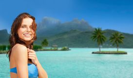 Happy woman in bikini swimsuit on bora bora beach Stock Photo
