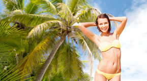 Happy woman in bikini swimsuit over palm tree Stock Photography