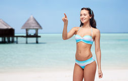 Happy woman in bikini swimsuit pointing finger Royalty Free Stock Photo