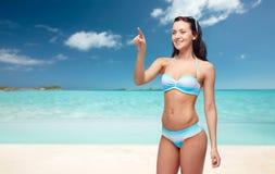 Happy woman in bikini swimsuit pointing finger Stock Photos
