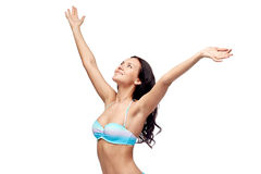 Happy woman in bikini swimsuit with raised hands Stock Photography