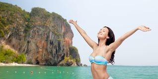 Happy woman in bikini swimsuit with raised hands Royalty Free Stock Photos