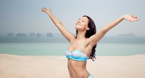Happy woman in bikini swimsuit with raised hands Royalty Free Stock Image
