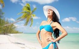 Happy woman in bikini swimsuit on tropical beach Stock Image