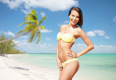 Happy woman in bikini swimsuit on tropical beach Royalty Free Stock Image