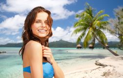 Happy woman in bikini swimsuit on tropical beach Stock Photo