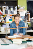Happy Woman Binding Papers At Workbench Stock Photography