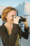 Happy woman with binoculars Royalty Free Stock Images