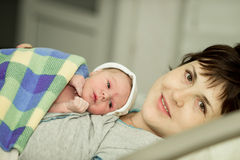 Happy woman after birth with a newborn baby Royalty Free Stock Images