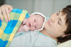 Happy woman after birth with a newborn baby Stock Photos