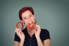 Happy woman bites in a slice of pepper Stock Photo