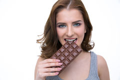 Happy woman biting in a chocolate tablet Stock Image