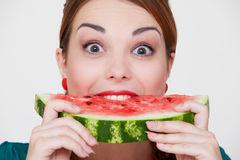 Happy woman biting slice of watermelon Royalty Free Stock Images