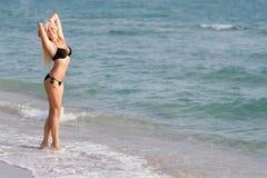 Happy woman in black bikini on sea background Stock Image