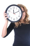 Happy woman in black with clock Royalty Free Stock Photos