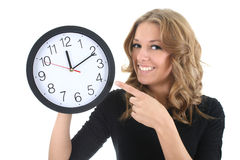 Happy woman in black with clock. Over white Stock Photo