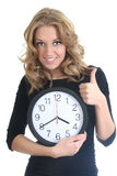 Happy woman in black with clock. Showing thumbs up over white Royalty Free Stock Images