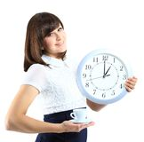 Happy woman in black with clock and cup of tea Royalty Free Stock Photography