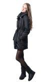 Happy woman in black coat Stock Image