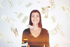 Happy woman in black, dollar bills falling Royalty Free Stock Image