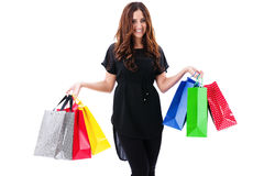 Happy woman in black dress with shopping bags Stock Images