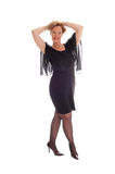 Happy woman in black dress standing. Royalty Free Stock Image