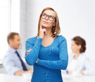 Happy woman in black eyeglasses dreaming. Happiness, business, office and people concept - happy smiling young women in black eyeglasses dreaming Royalty Free Stock Photography