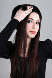 Happy woman in black fur hat Stock Image