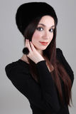 Happy woman in black fur hat Royalty Free Stock Photos
