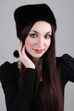 Happy woman in black fur hat Royalty Free Stock Images