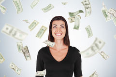 Happy woman with black hair, dollar bills falling Stock Photography
