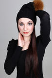 Happy woman in black hat Royalty Free Stock Image