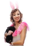 Happy woman with black rabbit Royalty Free Stock Photos