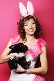 Happy woman with black rabbit Stock Images