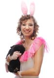 Happy woman with black rabbit Stock Image