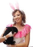 Happy woman with black rabbit Stock Photos