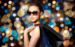 Happy woman in black sunglasses with shopping bags Stock Image