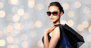 Happy woman in black sunglasses with shopping bags Royalty Free Stock Photos