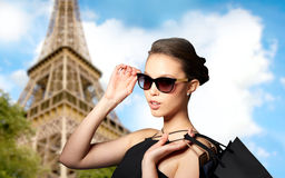 Happy woman in black sunglasses with shopping bags Royalty Free Stock Images