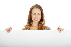 Happy woman with blank board. Royalty Free Stock Photos