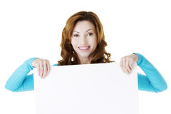 Happy woman with blank board Royalty Free Stock Images