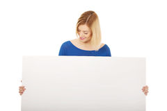 Happy woman with blank board. Stock Image