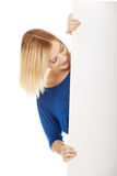 Happy woman with blank board. Royalty Free Stock Photo