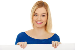 Happy woman with blank board. Stock Photo